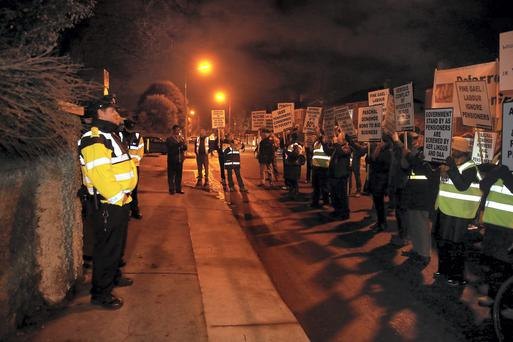Aer Lingus and DAA workers protest outsde Minister Joan Burton's house
