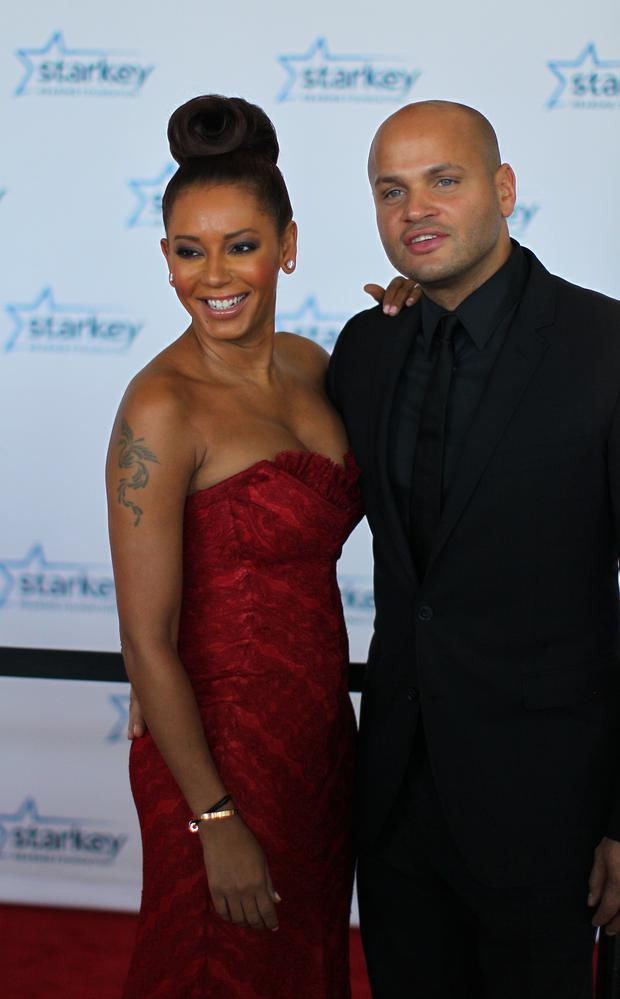Mel Brown and her husband Stephen Belafonte walk the red carpet before a Gala on July 28, 2013