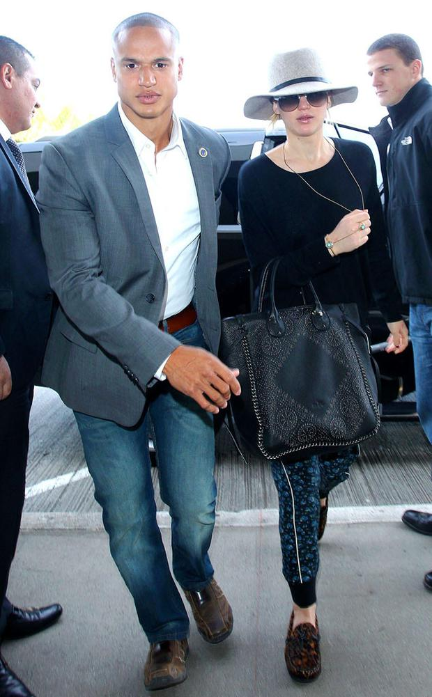 Jennifer Lawrence and her hot bodyguard at LAX