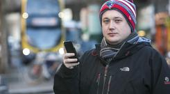 Uber in Dublin: Frank Whelan waits for his Uber to arrive on the streets of the capital.