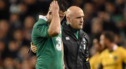Johnny Sexton leaves the field, with team doctor Dr. Eanna Falvey, during the November International Series game against Australia