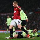 Paul Scholes is tackled by Fabricio Coloccini during the Manchester United v Newcastle game on St Stephen's Day in 2012. Clive Brunskill/Getty Images