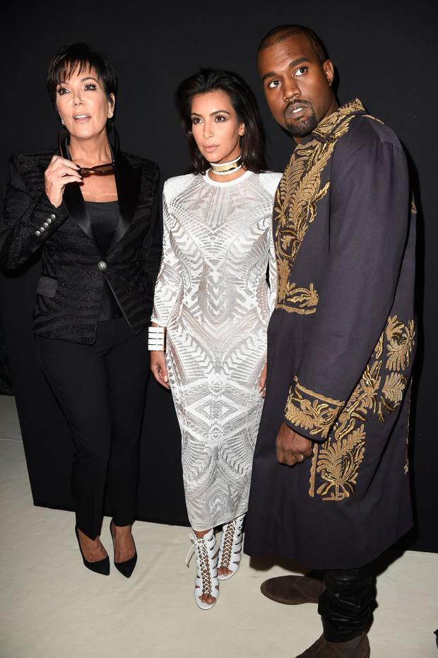 (L-R) Kris Jenner, Kim Kardashian and Kanye West attend the Balmain show as part of the Paris Fashion Week
