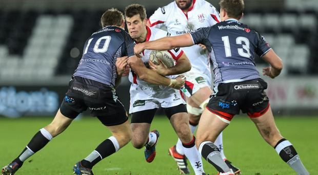 Ulster full-back Louis Ludik is tackled by Ospreys pair Dan Biggar and Ashley Beck during their Guinness Pro12 clash at the Liberty Stadium. Photo: Steve Pope / SPORTSFILE