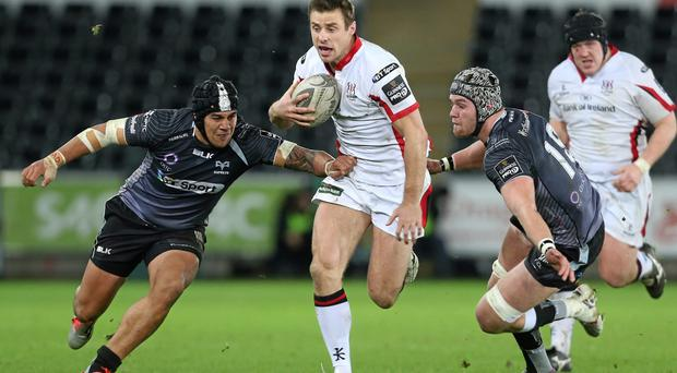 Ulster winger Tommy Bowe breaks through tackles from Ospreys pair Josh Matavesi and Dan Lydiate during their Guinness Pro12 clash at the Liberty Stadium. Photo: Steve Pope / SPORTSFILE