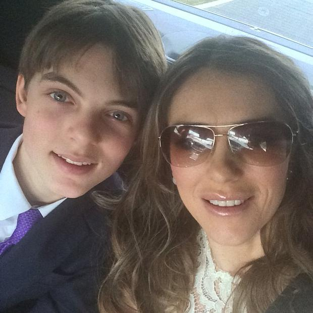 Liz Hurley pictured with her son on the way to Furnish/John nuptials.