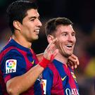 Lionel Messi with Barcelona teammate Luis Suarez