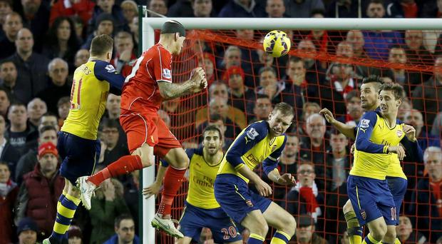 Liverpool's Martin Skrtel (2nd L) scores a goal against Arsenal