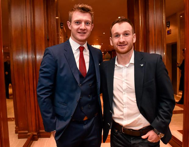 Galway hurler Joe Canning with Dundalk FC captain Stephen O'Donnell, during the Croke Park Hotel / Irish Independent Sportstar of the Year Luncheon 2014