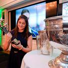 Five-time world champion Katie Taylor checks out her trophy having been voted Irish Independent / Croke Park Hotel 2014 Sportstar of the Year at the awards ceremony in The Westbury. Photo: Barry Cregg / SPORTSFILE