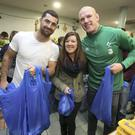 Ireland rugby players, Paul O'Connell and Rob Kearney with volunteer, Clodagh Shortall on a visit to the Capuchin Day Centre to help pack christmas hampers. Pic. Damien Eagers.