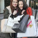 Andrea Browne, 18, left, and Luiza Fergus, 18, from Dundalk, with their shopping bags on Dublin's Grafton Street. Picture credit; Damien Eagers 19/12/2014