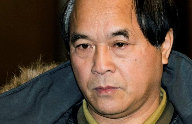 Diran Lin, father of Jun Lin, leaves the Montreal Courthouse following the murder trial for Luka Magnotta, yesterday, where a jury found Magnotta guilty of killing and dismembering Jun Lin, his Chinese lover, and mailing the body parts to schools and political parties around the country (AP Photo/The Canadian Press, Graham Hughes)