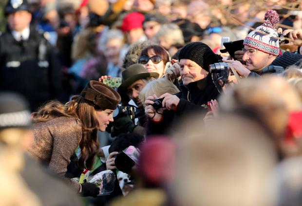 Kate Middleton talks to wellwishers as she leaves St Mary Magdalene Church on the Sandringham estate in Norfolk following the traditional Christmas Day service with Prince Harry. PRESS ASSOCIATION Photo. Picture date: Thursday December 25, 2014. See PA story ROYAL Christmas. Photo credit should read: Chris Radburn/PA Wire