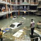FILE - In this Dec. 28, 2004 file photo, rescue and clean-up crew survey a flooded lobby at the Seapearl Beach Hotel along Patong Beach on Phuket Island, Thailand, after massive tsunami waves smashed coastlines Sunday morning. Friday marks the 10th anniversary of one of the deadliest natural disasters in world history: a tsunami, triggered by a massive earthquake off the Indonesian coast, leaving more than 230,000 people dead in 14 countries and causing about $10 billion in damage. Countries from Indonesia to India to Africa's east coast were hit, leaving shocking scenes of death and destruction. (AP Photo/ CP, Deddeda Stemler, File)...I