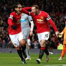 Wayne Rooney celebrates with teammate Radamel Falcao after giving Manchester United the lead in their Premier League clash with Newcastle United at Old Trafford. Photo: Alex Livesey/Getty Images