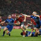 Andrew Conway beats the tackles of Leinster pair Isaac Boss and Darragh Fanning to score Munster's second try in their Guinness Pro12 clash at Thomond Park. Photo: Brendan Moran / SPORTSFILE