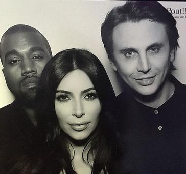 Kim and Kanye photographed in Kris Jenner's party photo booth with family friend Jonathan Cheban