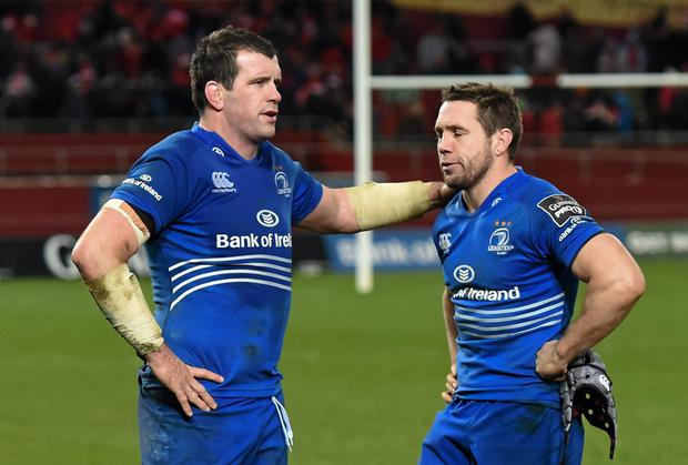 Leinster players Shane Jennings and Isaac Boss following their defeat to Munster