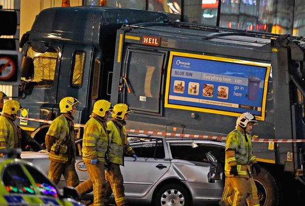 Four people are still being treated in hospital a week after the bin lorry crash in Glasgow in which six people died. Jeff J Mitchell/Getty Images