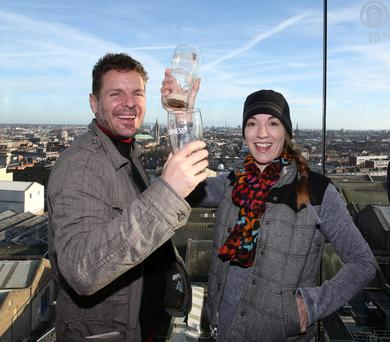 Tourists Reuben and Tammy Dunseath from Florida enjoying a Guinness in the Gravity Bar of the Guinness Store House in Dublin earlier this week; the storehouse is our most-visited paid tourist attraction.