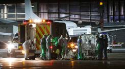 An Ebola patient is transferred on to a Hercules transport plane at Glasgow Airport in Scotland December 30, to be transported to London. A healthcare worker has been diagnosed with Ebola a day after flying home to Glasgow from Sierra Leone, the Scottish government said on Monday. UK Health Secretary Jeremy Hunt confirmed that the woman would be flown to a specialist unit at Royal Free Hospital in London, local media reported (REUTERS/Stringer)
