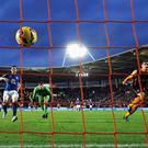 Nikica Jelavic of Hull City touches the ball over goalkeeper Joel Robles of Everton