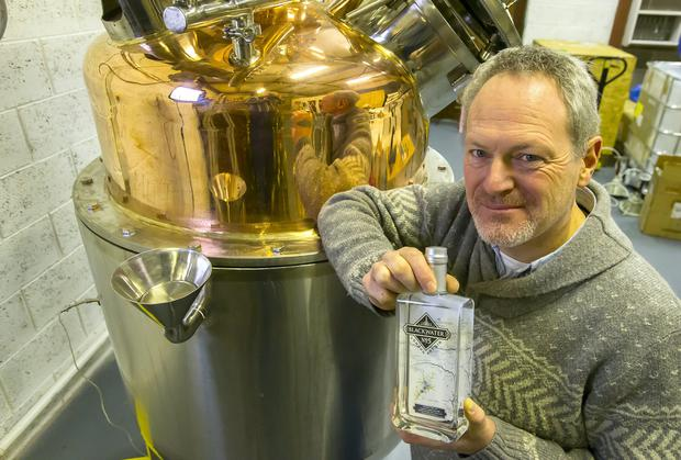 """Peter Mulryan of the Blackwater Distillery, Cappoquin, Co Waterford. In the background is """"Sally"""" a Copper Pot Still. Picture: Patrick Browne"""
