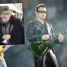 Bono (right) plays guitar while Adam Clayton plays bass as U2 performs at Soldier Field on Tuesday, July 5, 2011. | Richard A. Chapman~Sun-Times