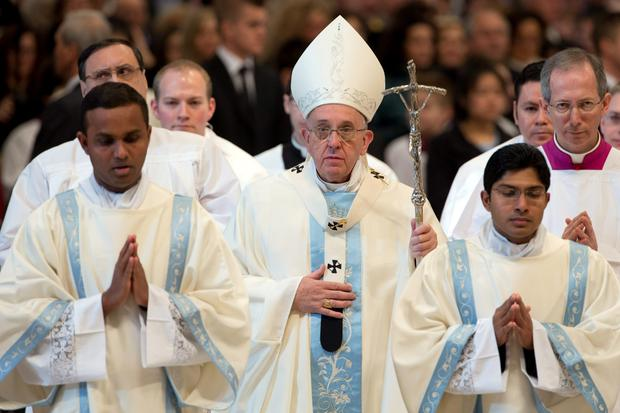 Pope Francis leaves at the end of a New Year mass he celebrated in St. Peter's Basilica at the Vatican, Thursday, Jan. 1, 2015