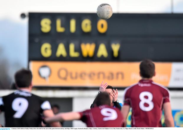 Referee Paddy Neilan, throw the ball for the start of the game between Galway and Sligo.