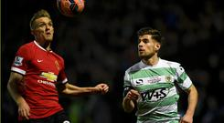 Joseph Edwards of Yeovil and Darren Fletcher of Manchester United chase the ball during their FA Cup third round soccer match at Huish Park