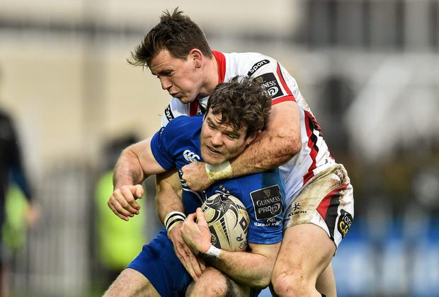 Leinster centre Gordon D'Arcy is tackled by Ulster's Craig Gilroy during their Guinness Pro12 clash at the RDS. Photo: Ramsey Cardy / SPORTSFILE