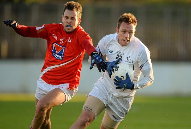 Kildare's Eamon Murphy in action against David McComish of Louth during their O'Byrne Cup clash at St Conleth's Park. Photo: Piaras Ó Mídheach / SPORTSFILE