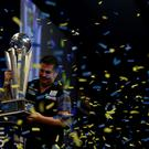 Gary Anderson celebrates with the Sid Waddell trophy after defeating Phil Taylor of England in the final of the 2015 William Hill PDC World Darts Championships at Alexandra Palace