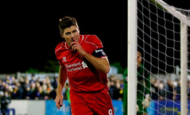 Steven Gerrard of Liverpool celebrates after scoring the opening goal with a header against Wimbledon