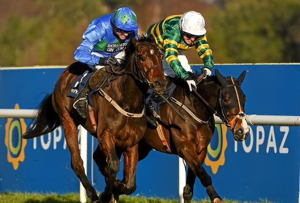 Hurricane Fly, with Ruby Walsh up, on their way to winning the Ryanair Hurdle, and his 21st Grade 1 victory which is a new world record, ahead of eventual second place Jezki, with Tony McCoy up
