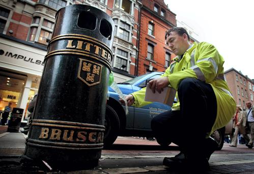 Senior little warden checks out a bin on Grafton Street