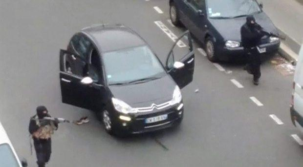 Gunmen flee the offices of French satirical newspaper Charlie Hebdo in Paris, in this still image taken from amateur video shot on January 7, 2015, and obtained by Reuters. Reuters/Handout via Reuters TV