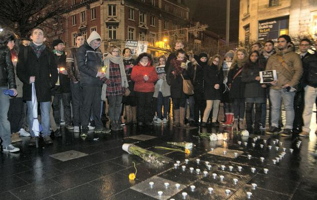 Members of the public during a vigil on O' Connell Street Dublin for people killed in a shooting at the Paris offices of French satirical weekly magazine Charlie Hebdo. Photo: Gareth Chaney Collins