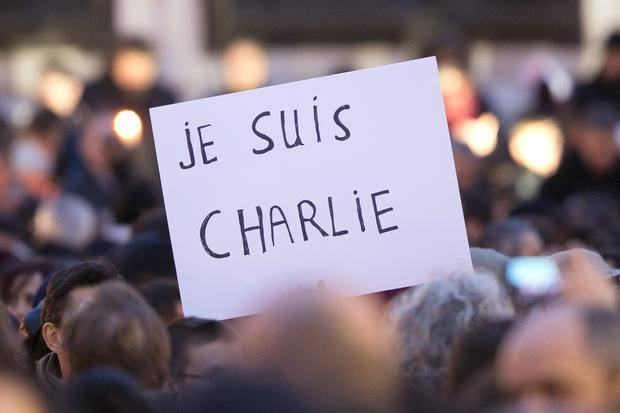 PARIS, FRANCE - JANUARY 07: Signs saying 'Je suis Charlie' are held up as crowds gather at 'Place de la Republique' for a vigil following the terrorist attack earlier today on January 7, 2015 in Paris, France. Twelve people were killed, including two police officers, as two gunmen opened fire at the offices of the French satirical publication Charlie Hebdo. (Photo by Marc Piasecki/Getty Images)