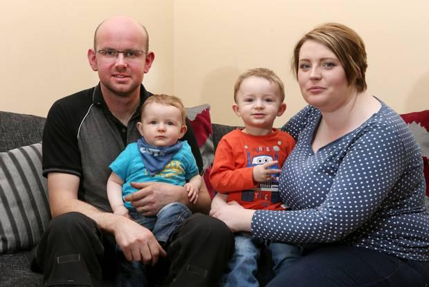 Elisha McGill and her husband Dermot with Bobby (nine months) and 22-month-old Ollie in their home yesterday