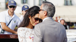 Actor George Clooney and Amal Alamuddin at Piazza San Marco in Venice this September. Photo by Ernesto Ruscio/GC Images