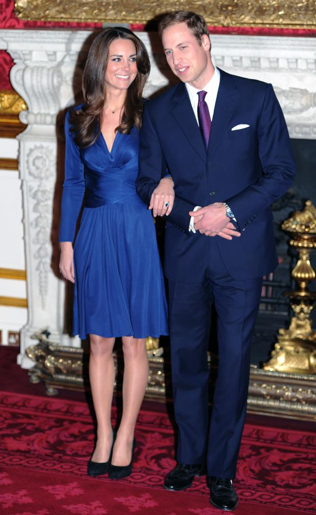 November 2010: Kate's royal blue Issa wrap dress was picture perfect for her engagement announcement.