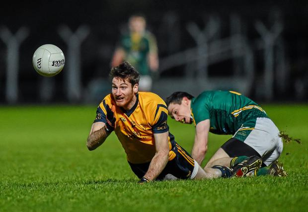 Brian Donnelly, DCU, in action against Donncha Tobin, Meath