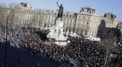 People start gathering at Republique square before the demonstration, in Paris, France.