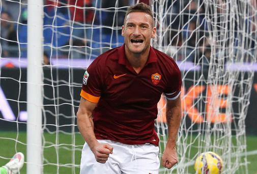 Francesco Totti celebrates scoring for Roma - Arup are monitoring the club's stadium