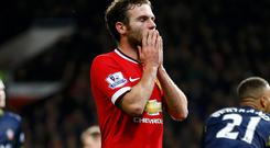 Juan Mata reacts after missing a chance