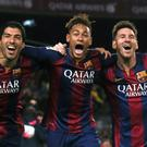 Luis Suarez, Neymar and Lionel Messi celebrate Barcelona's victory over Atletico Madrid in the Nou Camp last night