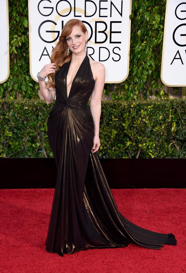 Golden Globes 2015: Actress Jessica Chastain adds a touch of elegance to this sexy dress.